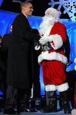 Obama with Santa, Natl Christmas Tree, AFP