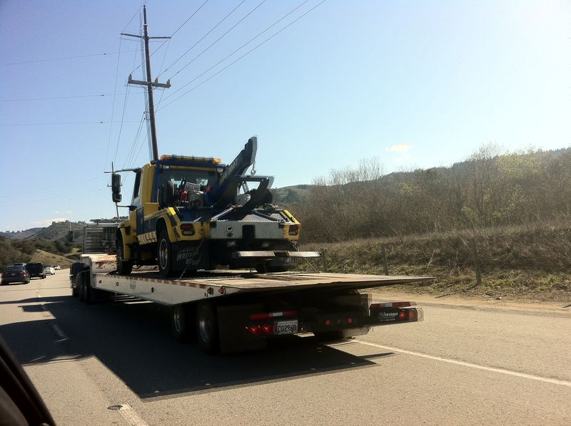 Tow truck on a flatbed