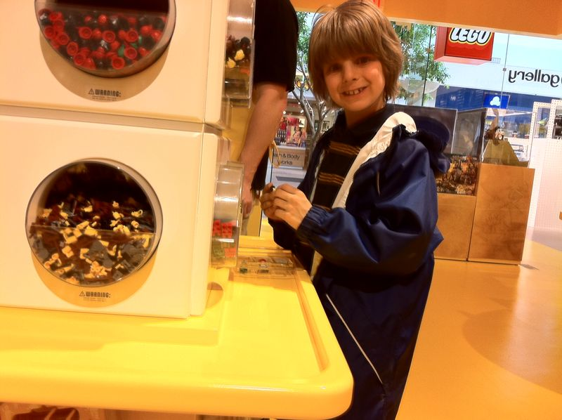 Cameron DeCloet, 7, checks out the mini-fig bar at the Lego store