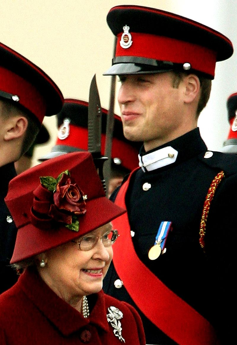 Queen Elizabeth passes her grandson Prince William as she inspects graduates ...