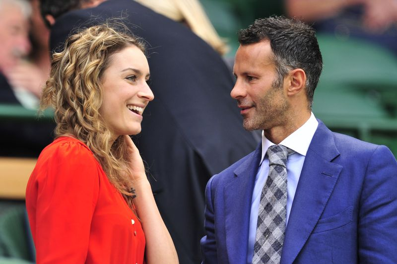 Wales and Manchester United footballer Ryan Giggs (R) chats to former British gold medalist skeleton athlete Amy WIlliams