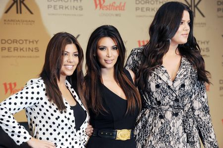 Kourtney Kardashian, Kim Kardashian and Khloe Kardashian Odom attend the photocall to launch the Kardashian Kollection for Dorothy Perkins at Westfield on November 10, 2012 in London