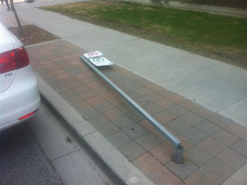 Downed parking sign