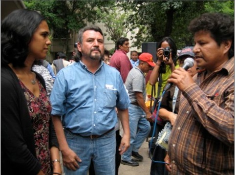 Abarca (mike) talks to Canadian embassy rep (female) in 2009