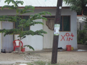 Blue and red spray-paint marks notice for many residents living within 15 meters of a future Bagamoyo - Dar Es Salaam water pipeline.